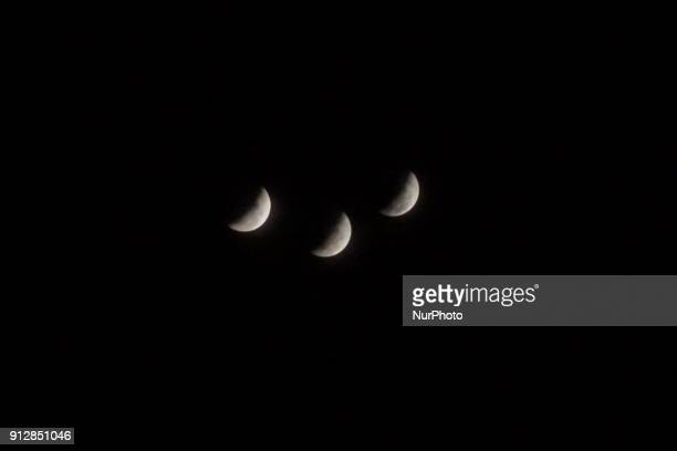 Photo taken using techniques photography quotmultiple exposurequot The moon is seen during a lunar eclipse referred to as the 'super blue blood moon'...