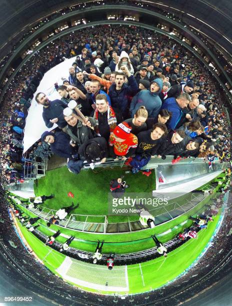 Photo taken with a 360degree camera shows Russian spectators cheering for the country during a football friendly against Argentina at Luzhniki...