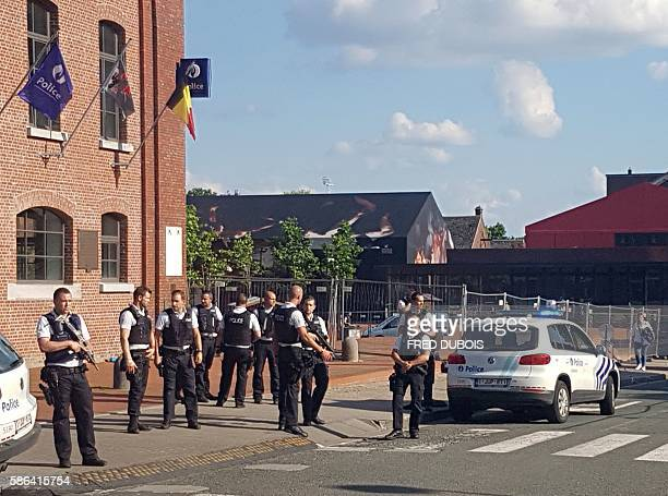 A photo taken with a mobile phone on August 6 shows police securing the area around a police building in the southern Belgian city of Charleroi...