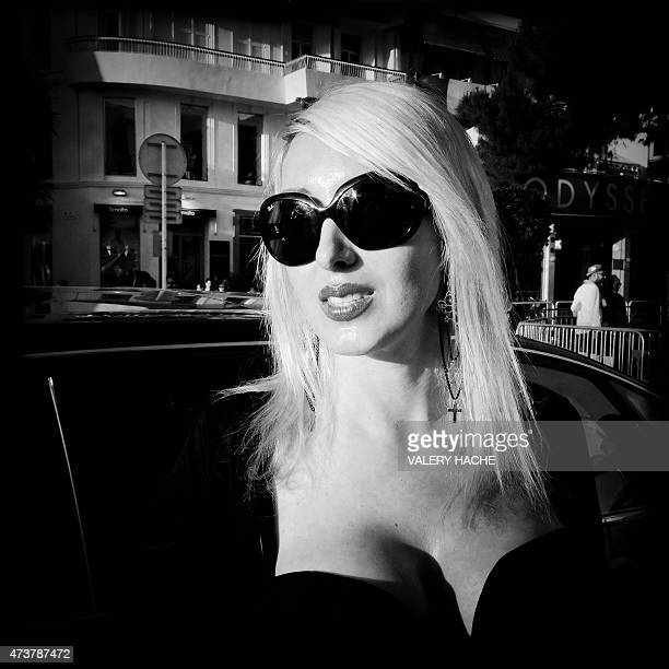A photo taken with a mobile phone shows a festival goer outside the Festival palace during the 68th Cannes Film Festival in Cannes southeastern...