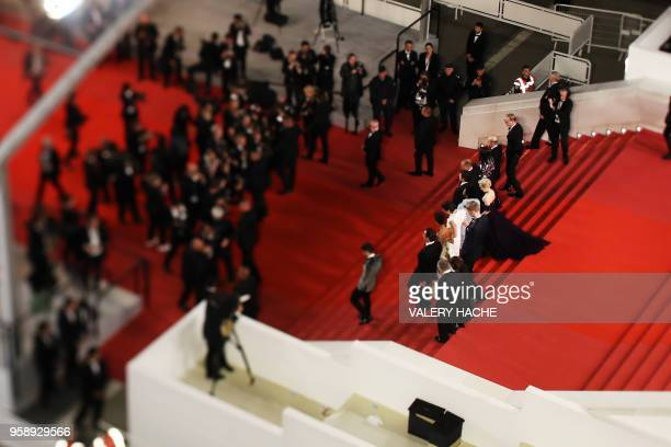 A photo taken with a tilt and shift lens shows British actor Paul Bettany US director Ron Howard US producer Kathleen Kennedy US actor Woody...
