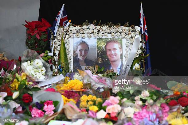 A photo tribute for Tori Johnson and Katrina Dawson is seen amongst flowers at a wreath laying ceremony after the funeral for Tori Johnson at Martin...