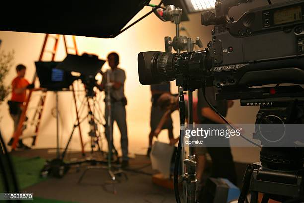 photo tv studio crew with camera - performance stock pictures, royalty-free photos & images