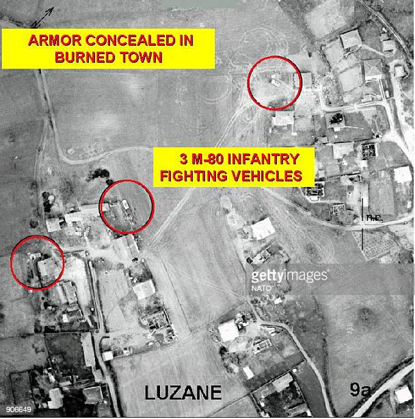 NATO photo which show an aerial view of of burned homes destroyed by Serbian forces with armored units hiding in the wreckage from NATO airstrikes in...