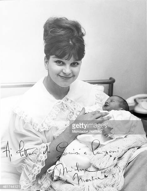 Photo with dedication to weekly magazine Sorrisi e Canzoni readers portraying the Italian singer Milva smiling while is keeping her newborn daughter...