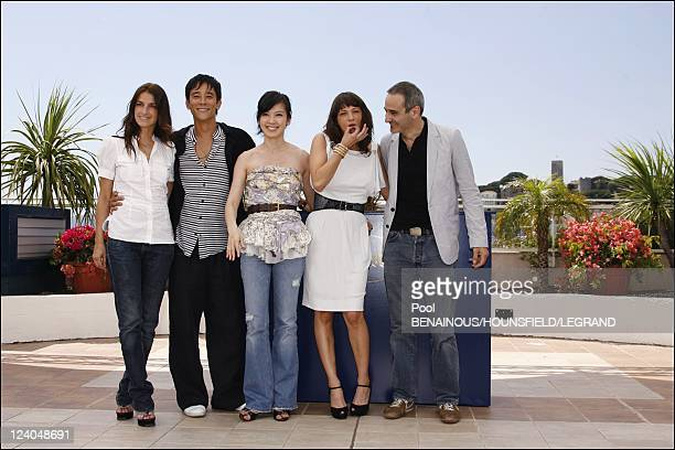 Photocall 'Boarding Gate' at the 60th Cannes International Film Festival France On May 18 2007 French director Olivier Assayas Italian actress Asia...