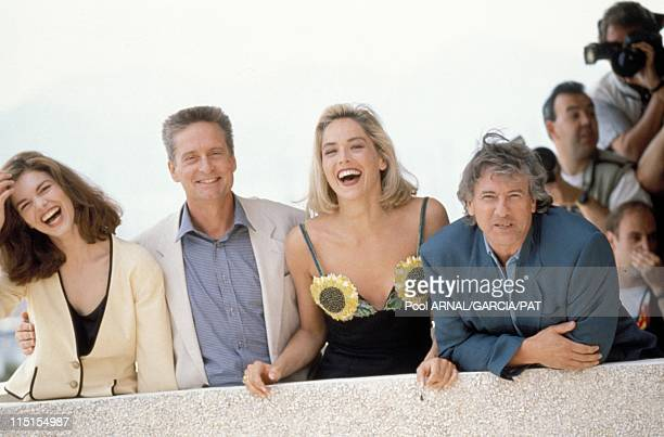 "Photocall of ""Basic Instinct"" at Cannes Film Festival in Cannes, France in May, 1991 - L-R: Jeanne Tripplehorn, Michael Douglas, Sharon Stone and..."