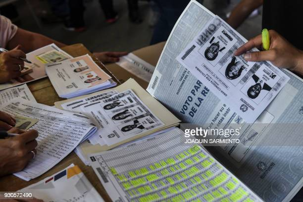 Photocopies of ballots for one of the two main political blocs holding primary elections at the same time of the parliamentary elections in Colombia...