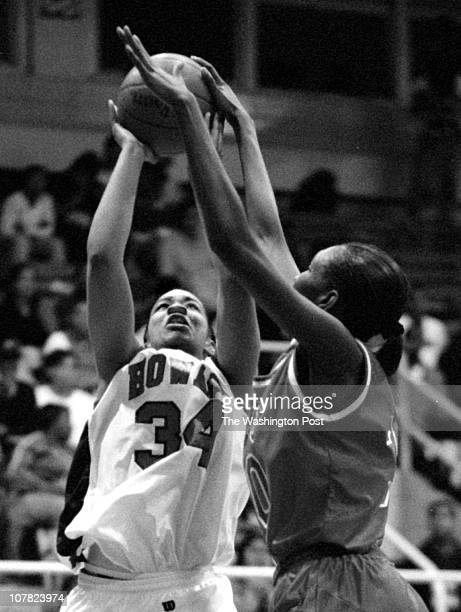 02/02/98 photog CRAIG HERNDON reporter C Cappellman location Burr Gym at Howard caption Howard women vs Florida AM Howard's Regan Carter has her jump...