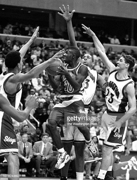 1/29/98 photog CRAIG HERNDON reporter GREENBERGER location MCI Center caption DeMatha vs Anderson of Indiana Anderson's Eric Bush works his way...