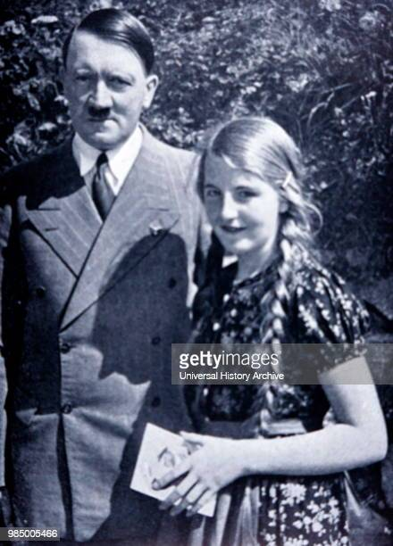 Photograph Adolf Hitler German politician who was the leader of the Nazi Party Chancellor of Germany with a young 'Aryan' German girl Dated 20th...