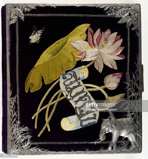 Photograph album 1893 It was made by Tiffany Co and includes silk thread silk velvet jet beads and a silver frame Souvenir from the Siamese Exhibit...