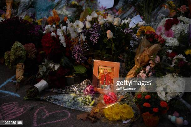 A photograph amidst flowers of victim Richard Gottfried at a memorial for victims of the mass shooting that killed 11 people and wounded 6 at the...