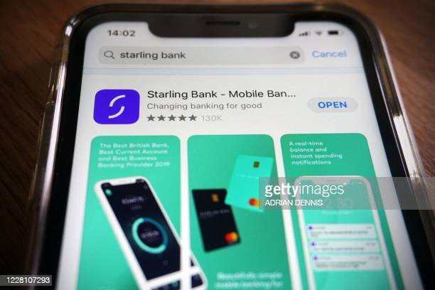 Photograph arranged as an illustration in Hartley Wintney, west of London on August 19, 2020 shows the Starling Bank banking app on a smart phone. -...