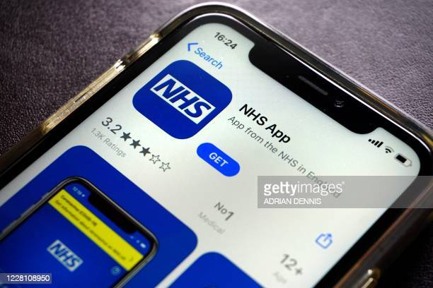 Photograph arranged as an illustration in Hartley Wintney, west of London on August 19, 2020 shows the NHS app, for Britain's NHS on a smart phone.