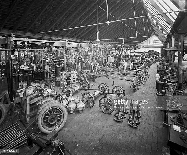 Photograph by Argent Archer Early motor cars were produced on a small scale with all parts fitted by hand until the advent in 1909 of Henry Ford's...