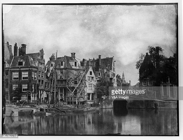 Photograph by Benjamin Brecknell Turner . One of the buildings is clad in timber scaffolding.