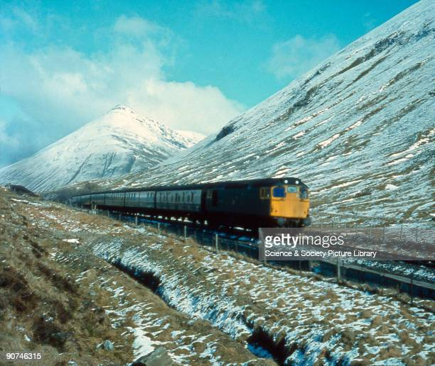 Photograph by Bishop Eric Treacy Against a backdrop of the conical peak of Ben Doran Argyll a Class 27 dieselelectric locomotive heads a Fort William...