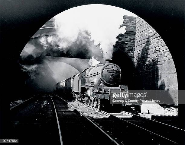 Photograph by Bishop Eric Treacy of the Jubilee Class 460 locomotive No 45567 'South Australia' travelling through the Edge Hill cuttings Treacy...