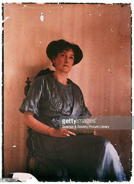Photograph by Etheldreda Janet Laing As if caught in a moment of quiet reflection this woman sits with a closed book in her lap It is possibly a...