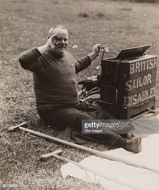 UNITED KINGDOM NOVEMBER 15 Photograph by Horace W Nicholls of a disabled British sailor begging at the famous horse race in Epsom Surrey
