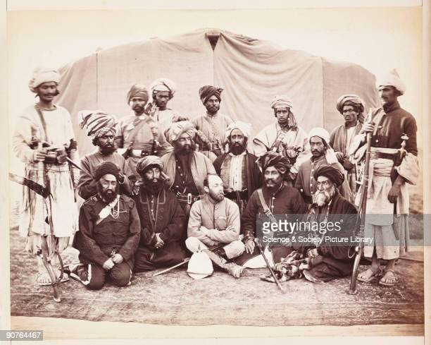 A photograph by John Burke [18451900] of Major Sir Pierre Louis Napoleon Cavagnari [18411879] sitting amongst a group of Afghan chieftains and army...
