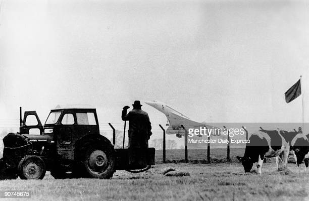 Photograph by John Downing 'a rural cowseye view of Concorde' A farmer stands beside his tractor watching the supersonic airliner taking off while...