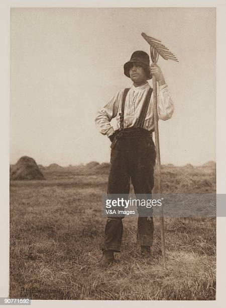 Photograph by Peter Henry Emerson of a farm worker with string tied round his trousers.