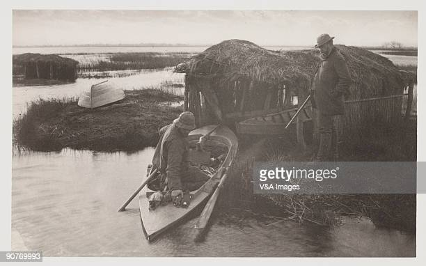 Photograph by Peter Henry Emerson showing men with their catch of birds