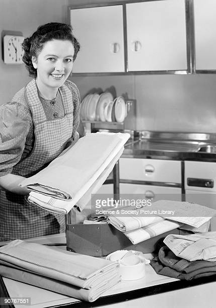 A photograph by Photographic Advertising Limited sold for use in Holland and New Zealand Before most people had washing machines laundry could be...