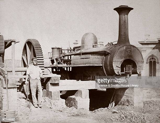 Photograph by R H Bleasdale showing the steam locomotive 'Adelaide' serving as a stationary engine driving a mortar mill during the construction of...