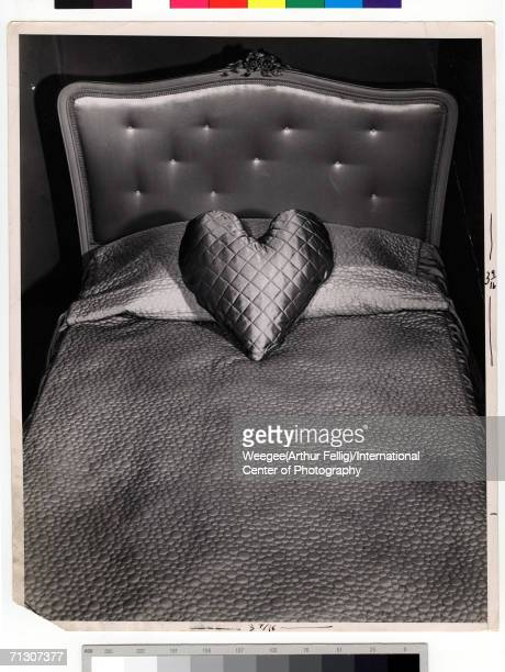 Photograph by Weegee of an heartshaped pillow on a twin bed circa 1945 Photo by Weegee / International Center of Photography / Getty Images
