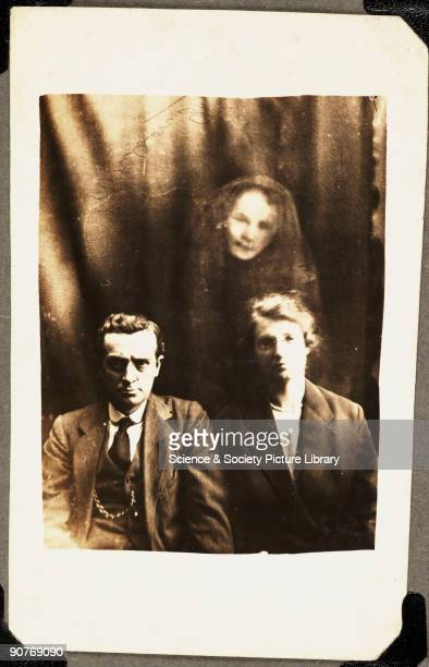A photograph by William Hope A woman's face appears above the couple identified at the time as the sister of a man prominent in the Spiritualist...