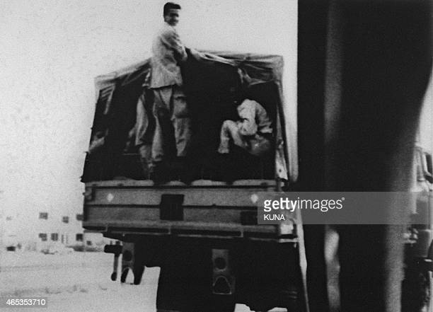 Photograph dated 03 August 1990 showing Iraqi soldiers in a military transport truck in a street of Kuwait city was released by the official Kuwaiti...