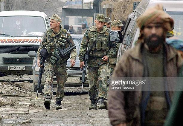 Photograph dated 23 February 2003 showing German soldiers of the International Security Assistance Force patrolling a street in Kabul. German Defense...
