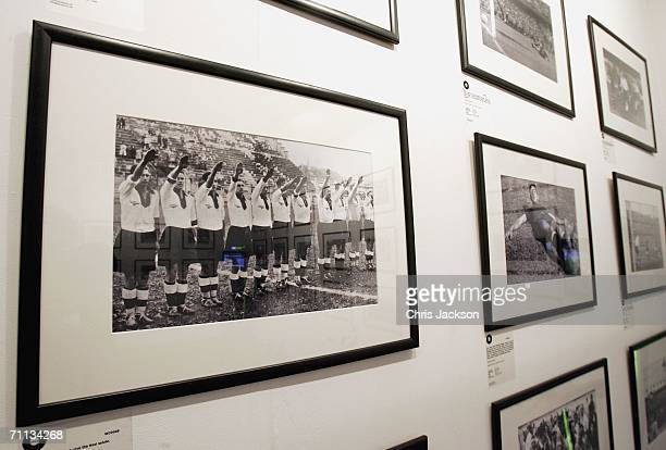 A photograph from 1938 showing the German football team giving the Nazi salute hangs on the wall at the 'Shoot' World Cup photo exhibition at the...