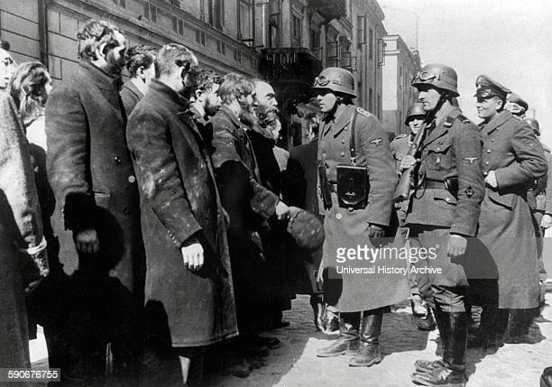 Photograph from Nowolipie Street with Josef Blösche member of the National Socialist German Workers Party stopping Jewish Rabbis Dated 1940