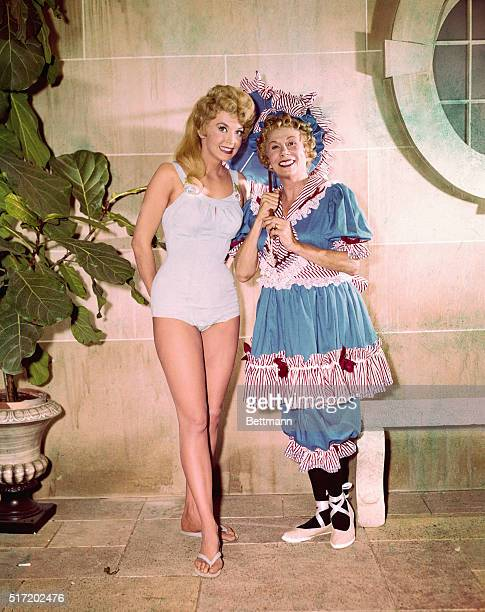 Photograph from The Beverly Hillbillies with Bea Benaderet in an 1890's bathing suit costume as cousin Pearl Bodine She stands next to Donna Douglas...