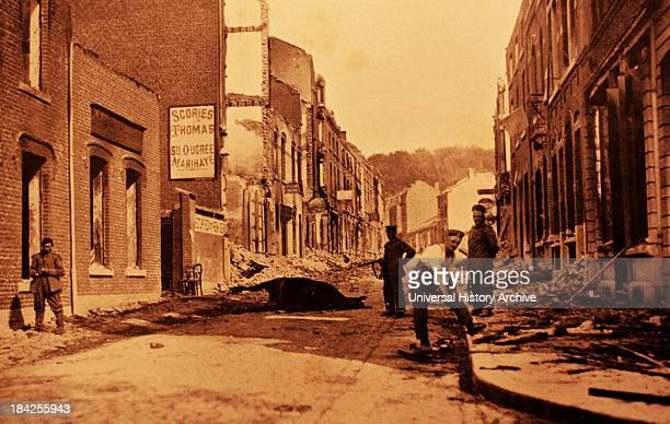 A photograph from the First World War showing a street left destroyed after attacks A horse lies dead on the street next to a few living soldiers...