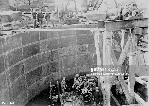 Photograph from the Pearson Archive showing a man in a diving suit with winch gear Engineered by Alexander Binnie the Blackwall Tunnel was built to...