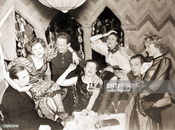 Photograph from the personal album of Eva Braun showing carnival celebrations at her parents' house in Munich, Germany, 1938. Among the group are her...