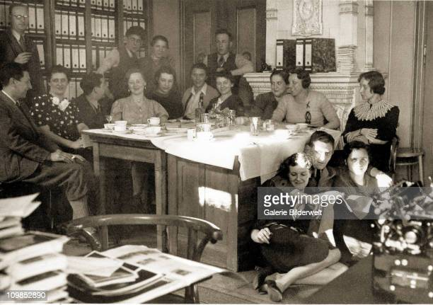 Photograph from the personal album of Eva Braun showing her colleagues at the office of the Heinrich Hoffmann photo agency, Munich, Germany, 1938....