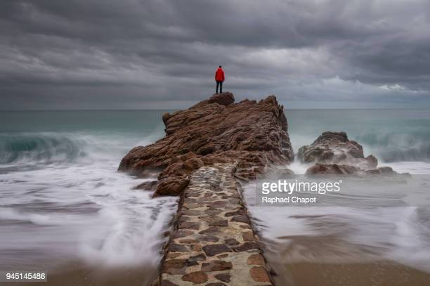 photograph in the plage des rochers cannes during moody weather, provence-alpes-côte-d'azur, france - wide angle stock pictures, royalty-free photos & images