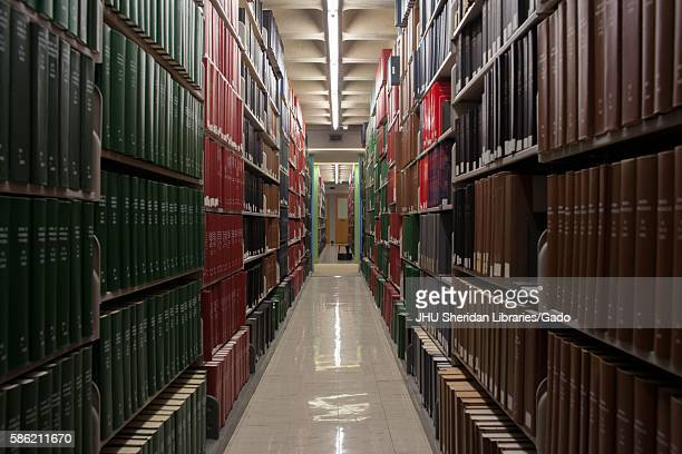 A photograph looking down the stacks of the library at Johns Hopkins University 2014 Courtesy Eric Chen
