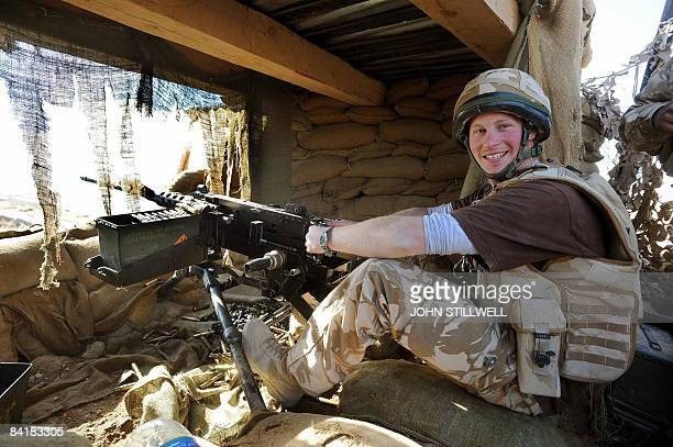 A photograph made available February 28 shows Britain's Prince Harry as he mans a 50mm machine gun on the observation post at JTAC Hill close to FOB...
