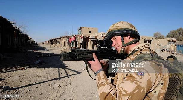 A photograph made available on February 28 shows Britain's Prince Harry on patrol through the deserted town of Garmisir close to FOB Delhi in Helmand...