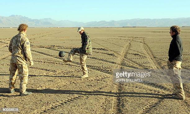 A photograph made available on February 28 shows Britain's Prince Harry playing football at dawn in the desert in Helmand province in Southern...