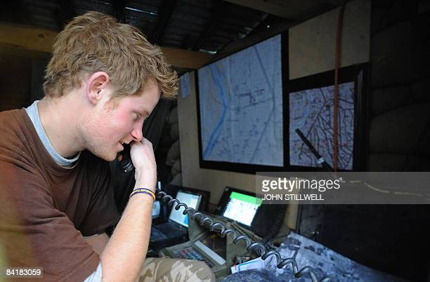 A photograph made available on February 28 shows Britain's Prince Harry as he talks to aircraft operating over Afghanistan from JTAC Hill close to...