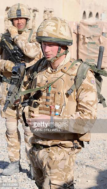 A photograph made available on February 28 shows Britain's Prince Harry as he listens to a briefing before going out on patrol through the deserted...