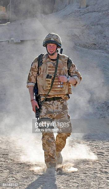 A photograph made available on February 28 shows Britain's Prince Harry on patrol through the deserted town of Garmisir close to FOB Delhi where he...